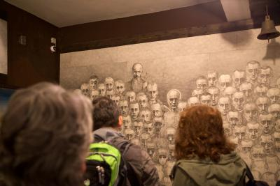 Participants of the study trip in the exhibition of the works of the former camp prisoner Marian Kołodziej