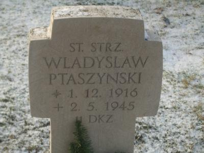 Tombstones and memorial plaque at the burial ground of polish soldiers