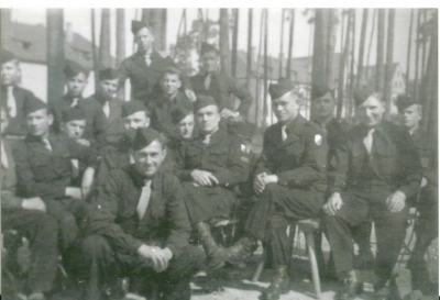 Zbigniew Muszyński in the middle on the chair, sitting third from the right.