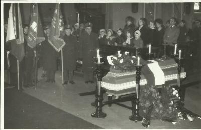 "The burial ceremony with flag bearers in Olesno. Janina Kłopocka's coffin is covered with the Polish flag  containing the ""Rodło"" emblem."