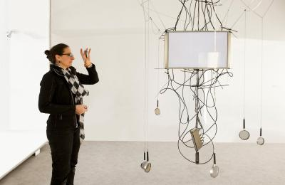 Karina Smigla-Bobinski standing next to her interactive video installation SIMULACRA, MoTA Museum of Transitory Art, Ljubljana, 2013.