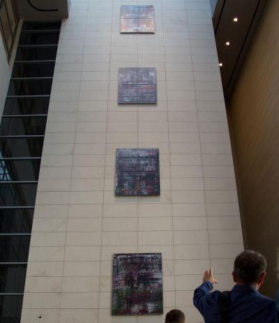 The picture cycle vertically aligned in the visitor foyer of the Reichstag building, Berlin 2019