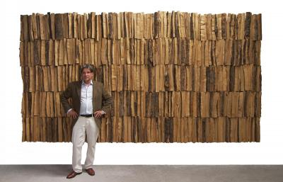 "Jan de Weryha standing in front of his work ""Wooden Panel"" (2001)"