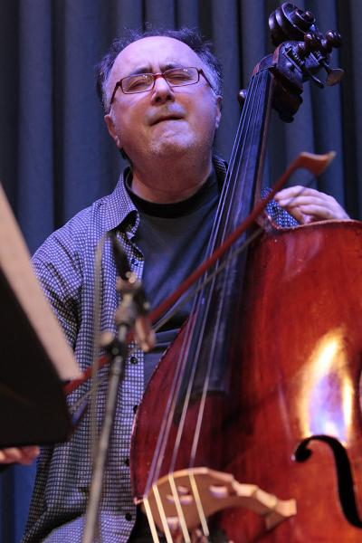 "Highly concentrated and attentive to what he is playing - Vitold Rek with his double bass, holding his bow. His virtuoso use of the bow is one of his trademarks. The photo was taken at the ""Just Music"" Jazz festival in Wiesbaden (2014)."